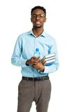 Happy african american college student standing with books in hi Stock Photo