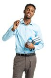 Happy african american college student standing with books in hi Stock Image