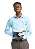 Happy african american college student standing with books in hi Stock Photography