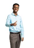 Happy african american college student standing with laptop and Stock Images
