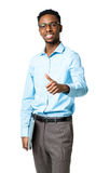 Happy african american college student standing with laptop and Royalty Free Stock Image