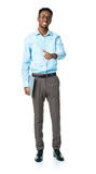 Happy african american college student standing with laptop and Royalty Free Stock Photography