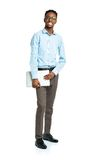 Happy african american college student standing with laptop on w Stock Photos