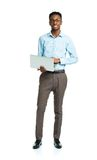 Happy african american college student standing with laptop on w Stock Image