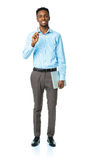 Happy african american college student standing with laptop on w Royalty Free Stock Image