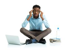 Happy african american college student in stress sitting with la Stock Photography