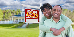 Happy African American Couple In Front of Beautiful House and So. Ld For Sale Real Estate Sign Stock Photos