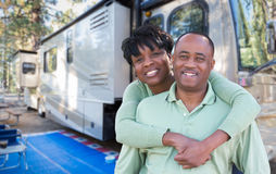 Happy African American Couple In Front of Their Beautiful RV At Royalty Free Stock Photo