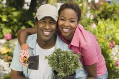 Happy African American Couple Gardening Stock Photos