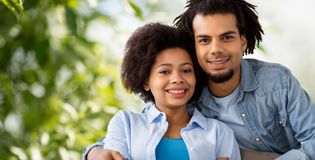 Happy african american couple hugging stock image