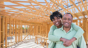 Happy African American Couple Inside Construction Framing of New. Happy African American Couple Ine Construction Framing of New House royalty free stock photo