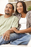 Happy African American Couple Sitting At Home Stock Photos