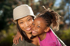 Happy African American Family. Happy African American mother and child having fun spending time together in a park Stock Photo
