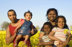 Happy african american family. African american parents and children in spring Stock Photography