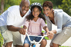 Free Happy African American Family & Girl Riding Bike Stock Photos - 20967793