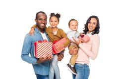 Happy african american family holding presents and smiling at camera. Isolated on white Stock Photo