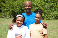 Happy African-American Family. Portrait of a happy, smiling African-american family - father, mother, and daughter.  The mother has cerebral palsy Stock Image
