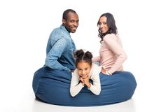 happy african american family sitting on bean bag chair stock image