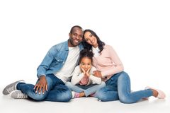 happy african american family sitting together and smiling at camera stock photography
