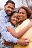 Happy African American Family Smiling Outside. African American mother and father with their daughter Royalty Free Stock Photography