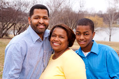 Happy African American Family Smiling Outside. African American mother and father with their two daughters Royalty Free Stock Photos