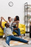 Happy african american family spending time together. At home stock photo