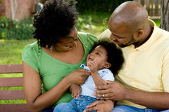 Happy African American family with their baby. Royalty Free Stock Photos