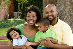 Happy African American family with their baby. stock photography