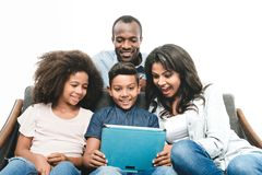 African american family with digital tablet. Happy african american family using digital tablet together isolated on white stock image