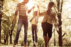 African American family walking trough park together. royalty free stock photography