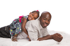 Happy African American Father with Baby Girl on Back Royalty Free Stock Image