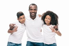 Happy african american father with kids. Embracing and smiling at camera isolated on white stock photo