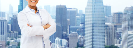 Happy african american female doctor over city Royalty Free Stock Images