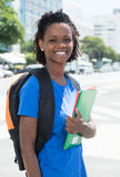 Happy african american female student in the city Stock Image
