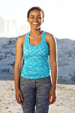 Happy african american fitness woman standing outside Stock Photography