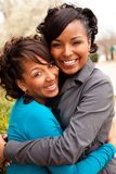 Happy African American women laughing and smiling. Happy African American friends laughing and smiling Stock Photography