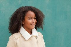 Happy African American girl with afro hair on a green background Stock Image