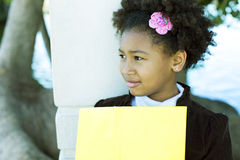 Happy african american girl with book stock photography