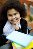 Happy african american girl with books Stock Photography
