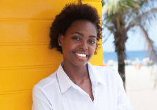 Happy african american girl near beach Stock Photo