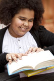 Happy african american girl reading Royalty Free Stock Photography