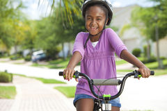 Happy African American Girl Riding Bike Smiling Stock Photo