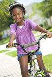 Happy African American Girl Riding Bike Smiling Royalty Free Stock Photos