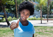 Happy african american girl showing thumb Royalty Free Stock Photography