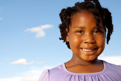Happy African American girl smiling outside. Royalty Free Stock Images