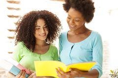 African american girls reading book, back to school Royalty Free Stock Images