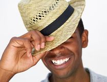 Happy african american guy holding his hat Stock Photography