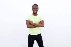 Happy african american guy smiling with arms crossed Royalty Free Stock Photo
