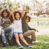 Happy African american little boy kid children joyfully cheerful and laughing. Concept of happiness, gladness and fun stock photo