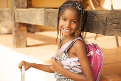 Happy african american little girl with backpack Stock Photos